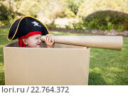 Купить «Cute boy pretending to be a pirate playing with cardboard spyglass», фото № 22764372, снято 3 марта 2016 г. (c) Wavebreak Media / Фотобанк Лори