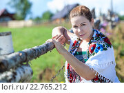 Купить «Attractive village woman with headscarf posing near fence», фото № 22765212, снято 20 июля 2013 г. (c) Кекяляйнен Андрей / Фотобанк Лори