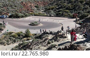 Купить «Square with circle road are after parking area in the Roque Cinchado rock formations in Teide National Park. Roques Garcia, Tenerife, Canary islands, Spain», видеоролик № 22765980, снято 18 февраля 2016 г. (c) Кекяляйнен Андрей / Фотобанк Лори