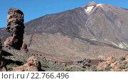 Купить «Camera view of the Roque Cinchado a unique rock formation and emblematic of the island of Tenerife. Roques Garcia, Canary Islands, Spain», видеоролик № 22766496, снято 18 февраля 2016 г. (c) Кекяляйнен Андрей / Фотобанк Лори