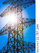 Купить «High voltage power pylon and sun», фото № 22787244, снято 6 января 2016 г. (c) Александр Подшивалов / Фотобанк Лори
