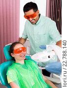 Купить «Laser teeth whitening», фото № 22788140, снято 20 марта 2018 г. (c) Яков Филимонов / Фотобанк Лори