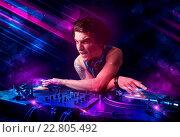 Купить «Young DJ playing on turntables with color light effects», фото № 22805492, снято 25 января 2020 г. (c) easy Fotostock / Фотобанк Лори