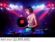 Купить «Teenager Dj mixing records in front of a crowd on stage», фото № 22805692, снято 25 января 2020 г. (c) easy Fotostock / Фотобанк Лори