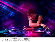 Купить «Young DJ playing on turntables with color light effects», фото № 22805892, снято 25 января 2020 г. (c) easy Fotostock / Фотобанк Лори