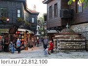 Купить «Europe, Bulgaria, Nessebar, People standing near shop», фото № 22812100, снято 20 сентября 2018 г. (c) age Fotostock / Фотобанк Лори
