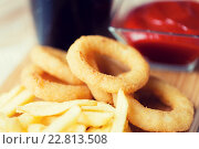 Купить «close up of fast food snacks and drink on table», фото № 22813508, снято 21 мая 2015 г. (c) Syda Productions / Фотобанк Лори