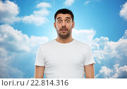 Купить «scared man in white t-shirt over sky background», фото № 22814316, снято 15 января 2016 г. (c) Syda Productions / Фотобанк Лори