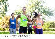 Купить «happy young sportsmen racing wit badge numbers», фото № 22814532, снято 16 августа 2015 г. (c) Syda Productions / Фотобанк Лори