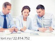 Купить «business team discussing something in office», фото № 22814752, снято 9 июня 2013 г. (c) Syda Productions / Фотобанк Лори