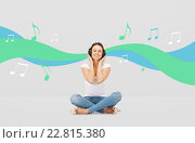 Купить «smiling young woman or teen girl in headphones», фото № 22815380, снято 2 апреля 2011 г. (c) Syda Productions / Фотобанк Лори