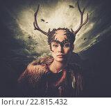 Купить «Woman shaman in ritual garment over dramatic stormy sky», фото № 22815432, снято 19 марта 2012 г. (c) Andrejs Pidjass / Фотобанк Лори