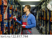 Worker on a automotive spare parts warehouse. Стоковое фото, фотограф Andrejs Pidjass / Фотобанк Лори