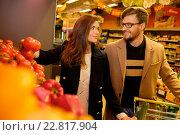 Купить «Couple choosing vegetables in a grocery store», фото № 22817904, снято 9 октября 2015 г. (c) Andrejs Pidjass / Фотобанк Лори