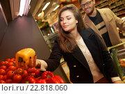 Купить «Couple choosing vegetables in a grocery store», фото № 22818060, снято 9 октября 2015 г. (c) Andrejs Pidjass / Фотобанк Лори