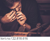 Купить «Portrait of a jeweler during the evaluation of jewels.», фото № 22818616, снято 26 декабря 2015 г. (c) Andrejs Pidjass / Фотобанк Лори