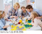Купить «Cheerful family having fun painting and decorating easter eggs.», фото № 22818996, снято 3 февраля 2016 г. (c) Andrejs Pidjass / Фотобанк Лори