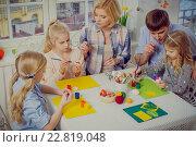 Купить «Cheerful family having fun painting and decorating easter eggs.», фото № 22819048, снято 3 февраля 2016 г. (c) Andrejs Pidjass / Фотобанк Лори