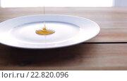 Купить «liquid honey pouring to plate on wooden table», видеоролик № 22820096, снято 15 апреля 2016 г. (c) Syda Productions / Фотобанк Лори