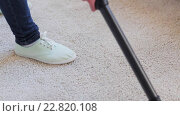 Купить «woman with vacuum cleaner cleaning carpet at home», видеоролик № 22820108, снято 17 апреля 2016 г. (c) Syda Productions / Фотобанк Лори