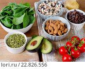 Купить «Foods containing potassium on a wooden table», фото № 22826556, снято 2 апреля 2016 г. (c) Tatjana Baibakova / Фотобанк Лори