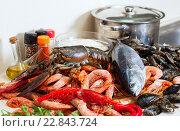 Купить «Fresh raw seafoods and fish at table», фото № 22843724, снято 4 мая 2013 г. (c) Яков Филимонов / Фотобанк Лори