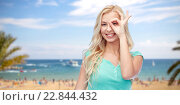 young woman making ok hand gesture. Стоковое фото, фотограф Syda Productions / Фотобанк Лори