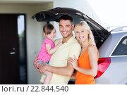 Купить «happy family with hatchback car at home parking», фото № 22844540, снято 11 августа 2015 г. (c) Syda Productions / Фотобанк Лори