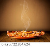 Купить «Fresh delicious home cooked pizza with steam», фото № 22854624, снято 24 сентября 2018 г. (c) easy Fotostock / Фотобанк Лори