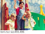 Купить «group of happy kids waving hands on playground», фото № 22855496, снято 13 июня 2015 г. (c) Syda Productions / Фотобанк Лори