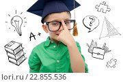 Купить «boy in bachelor hat and eyeglasses over doodles», фото № 22855536, снято 31 января 2016 г. (c) Syda Productions / Фотобанк Лори