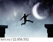 Купить «Businessman jumping over gap», фото № 22856552, снято 17 февраля 2019 г. (c) Sergey Nivens / Фотобанк Лори