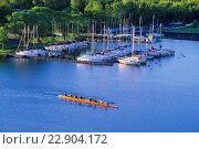 Купить «Team of rowers practising sculling near yacht club in Ramsay lake, Greater Sudbury, Ontario, Canada.», фото № 22904172, снято 19 ноября 2018 г. (c) age Fotostock / Фотобанк Лори