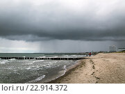 Купить «Warnemuende, Germany, dark clouds over the Baltic Sea», фото № 22914372, снято 21 октября 2015 г. (c) Caro Photoagency / Фотобанк Лори