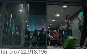 Купить «Travellers and People Meeting Them in Arrivals Hall», видеоролик № 22918196, снято 5 августа 2015 г. (c) Данил Руденко / Фотобанк Лори