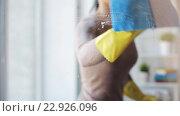 Купить «woman in gloves cleaning window with rag and spray», видеоролик № 22926096, снято 17 апреля 2016 г. (c) Syda Productions / Фотобанк Лори