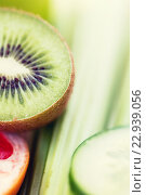 Купить «close up of ripe kiwi and cucumber slices», фото № 22939056, снято 17 марта 2015 г. (c) Syda Productions / Фотобанк Лори