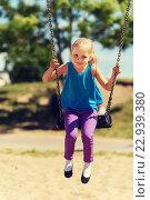 Купить «happy little girl swinging on swing at playground», фото № 22939380, снято 13 июня 2015 г. (c) Syda Productions / Фотобанк Лори
