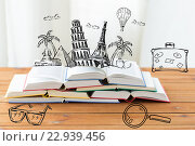 Купить «close up of books on table with landmarks doodles», фото № 22939456, снято 17 марта 2016 г. (c) Syda Productions / Фотобанк Лори