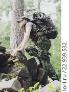 Купить «young soldier with backpack in forest», фото № 22939532, снято 14 августа 2014 г. (c) Syda Productions / Фотобанк Лори