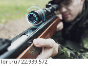 Купить «close up of soldier or sniper with gun in forest», фото № 22939572, снято 14 августа 2014 г. (c) Syda Productions / Фотобанк Лори
