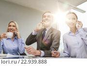 Купить «business team with smartphones having conversation», фото № 22939888, снято 9 ноября 2013 г. (c) Syda Productions / Фотобанк Лори