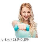 Купить «smiling beautiful young sporty woman with dumbbell», фото № 22940296, снято 30 апреля 2016 г. (c) Syda Productions / Фотобанк Лори