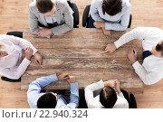 Купить «close up of business team sitting at table», фото № 22940324, снято 10 октября 2014 г. (c) Syda Productions / Фотобанк Лори