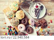 Купить «close up of sweets on table», фото № 22940584, снято 21 мая 2015 г. (c) Syda Productions / Фотобанк Лори
