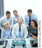 Купить «smiling business people with laptop in office», фото № 22940592, снято 25 октября 2014 г. (c) Syda Productions / Фотобанк Лори