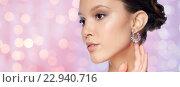 Купить «close up of beautiful woman face with earring», фото № 22940716, снято 9 апреля 2016 г. (c) Syda Productions / Фотобанк Лори