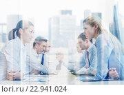 Купить «smiling business people having conflict in office», фото № 22941024, снято 25 октября 2014 г. (c) Syda Productions / Фотобанк Лори