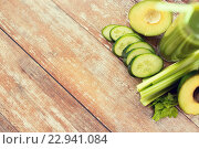 Купить «close up of fresh green juice glass and vegetables», фото № 22941084, снято 17 марта 2015 г. (c) Syda Productions / Фотобанк Лори