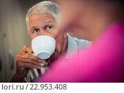 Купить «Senior drinking coffee during discussion», фото № 22953408, снято 22 марта 2016 г. (c) Wavebreak Media / Фотобанк Лори
